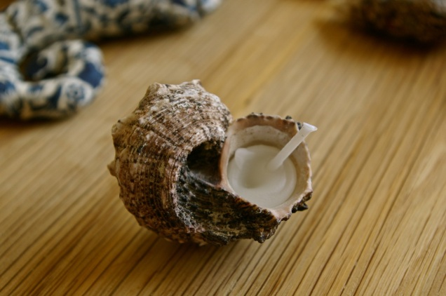 mini candle in a seashell