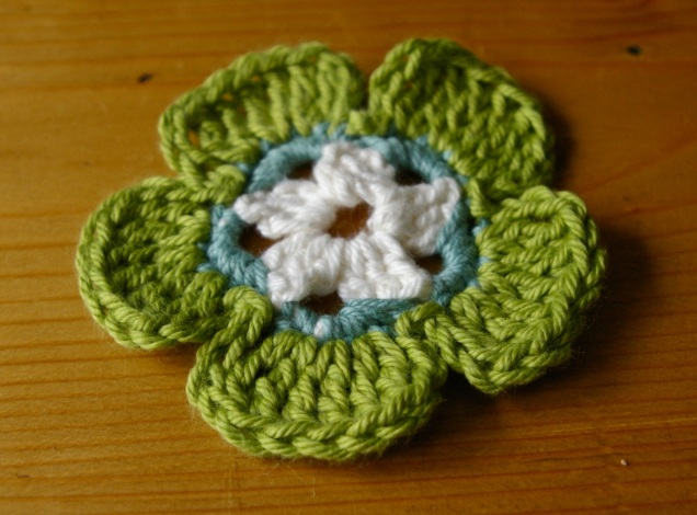 getting there...it's a hellebore (I just didn't have quite the right colour yarn)