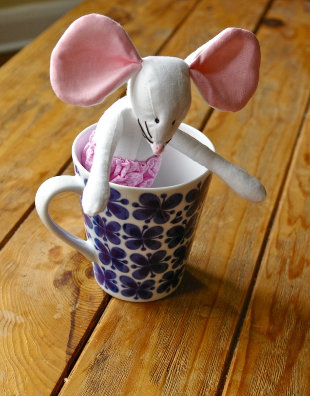 Mouse in a tea cup